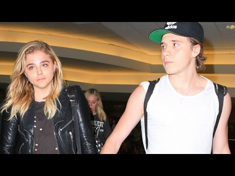 Brooklyn Beckham Gallantly Guides Girlfriend Chloe Moretz Through LAX