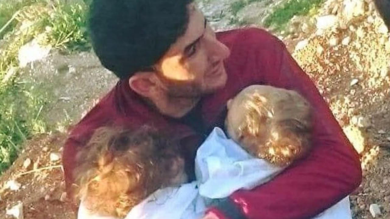 Syria gas attack: sobbing father cradles his dead twins
