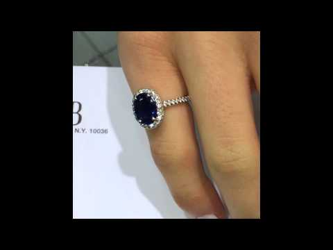 3 ct Blue Oval Sapphire in Diamond Halo Engagement Ring