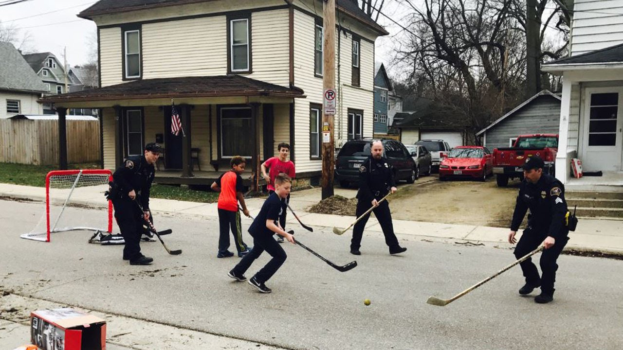 watch these cops join kids in a game of street hockey