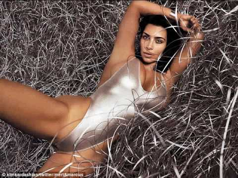 Kim Kardashian Wears Very High Cut Silver Swimsuit In