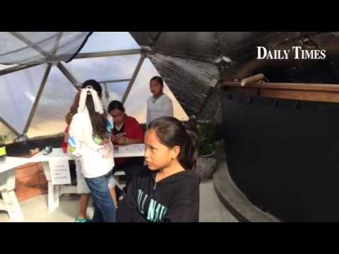 Nizhoni Elementary School students tour the new Growing Dome greenhouse.