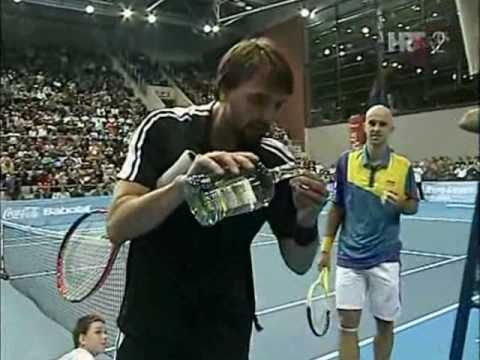 Ivanisevic offering schnaps to ref and tying his shoes