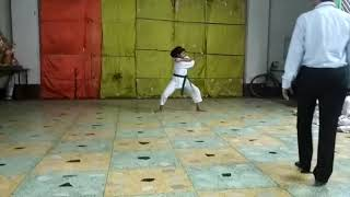 Karate girl is doing kata.