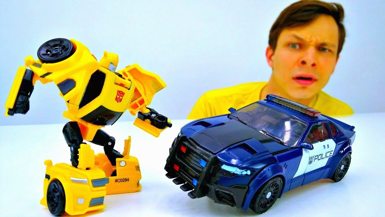 Машинки Трансформеры - Баррикейд vs Оптимус Прайм. Видео ...