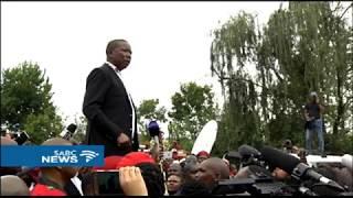 Malema addresses crowd outside mama Winnie's home