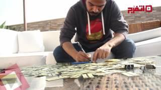شاب مصري يبتكر فن الرسم على تذاكر المترو ( اتفرج )