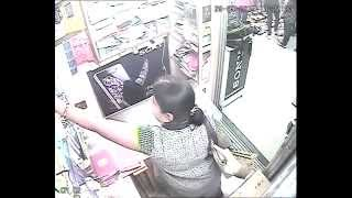 CCTV Video: Lady Steals A Smartphone & Walks Away; Dear Vendors, Please Be Cautious