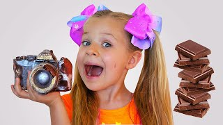 Diana and Roma play chocolate challenge with dad