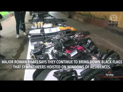 Marines bring down ISIS black flags in Marawi