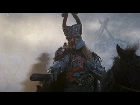 The 'Riders of doom' sequence from Conan the Barbarian, the action was so well synchronized with the music, that there was no need for exaggerated gore and chaotic sfx