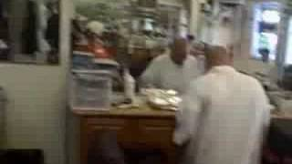"T.I. ""Swing Ya Rag"" Being Played @ Local Barbershop NYC 2"