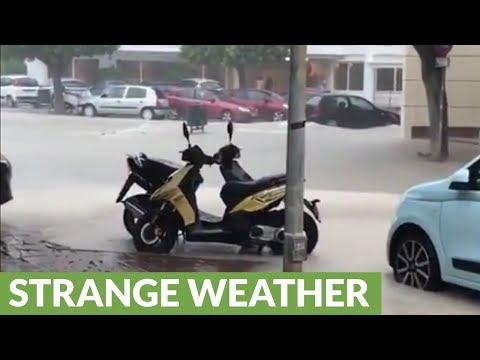 Heavy rains turn street into raging river in Ibiza