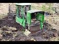 John Deere 1110E stuck in mud  saving with Homemade forwarder