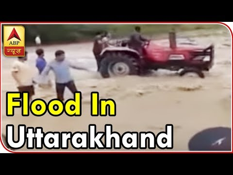 Uttarakhand: Video Shows How People Risk Lives And Travel On Flooded Roads | ABP News