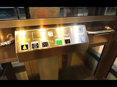 Sweden, Stockholm City train station, 4X SMW elevator - going up to street level from track 1-2