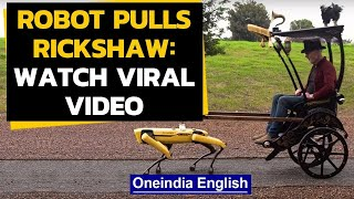 Robot pulls a rickshaw, video goes viral as it pulls a three-wheel passenger carriage|Oneindia News