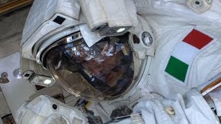 Spacewalk aborted after astronaut nearly drowns in own suit