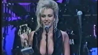 Kylie Ireland wins Best New Starlet at the 1995 AVN Awards