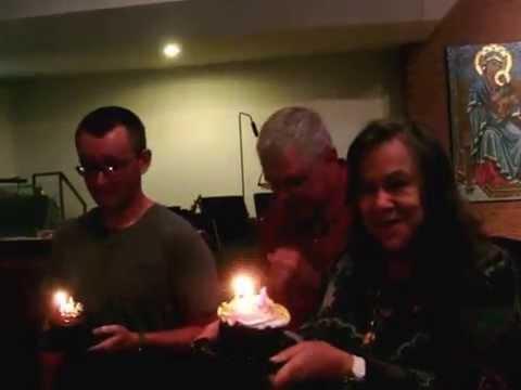Choir singing Happy Birthday Lucy