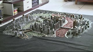 Chinese Young Man Presents City Map with 50,000 Odd Coins