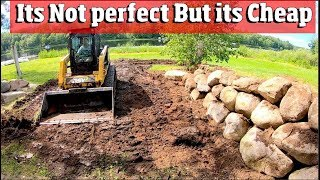 How to Install a CHEAP Boulder Retaining wall with just a skid steer and scrap field stones