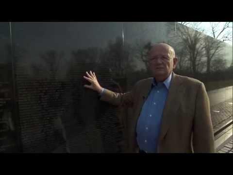 General Gordon R. Sullivan at the Wall discussing Norwich classmates