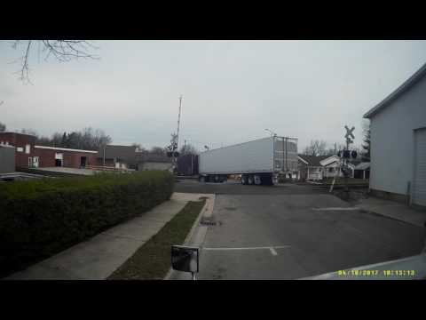 Crossing barrier comes down on trucker who breaks it and flees the scene