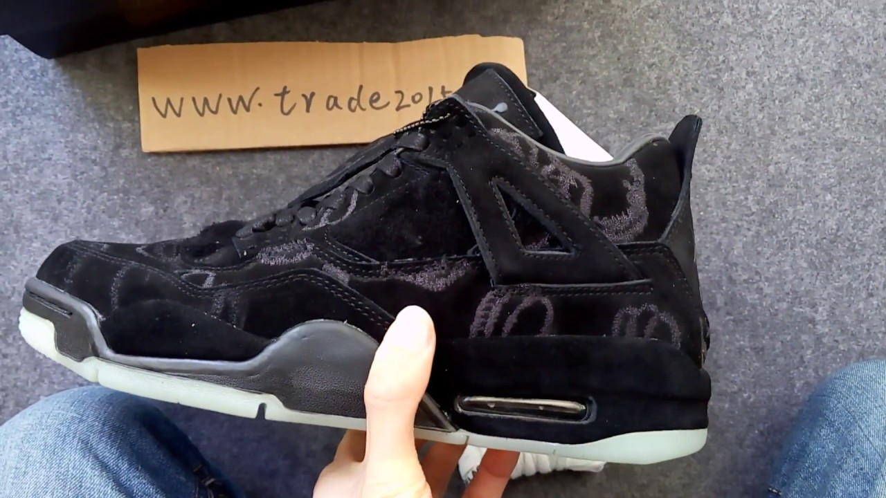 6823690be910b6 Kaws x Air Jordan 4 Black - YouTube