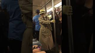 Subway creatures  old man in glasses and trench coat on train