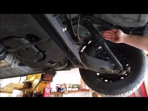 How To Replace Rear Shocks On A Nissan Sentra Youtube