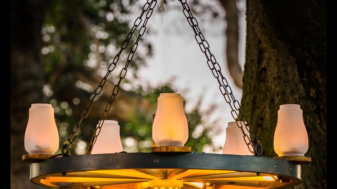 Wagon wheel chandelier youtube wagon wheel chandelier arubaitofo Image collections