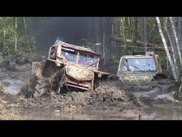 Off-Road vehicle mud race, wet forest.