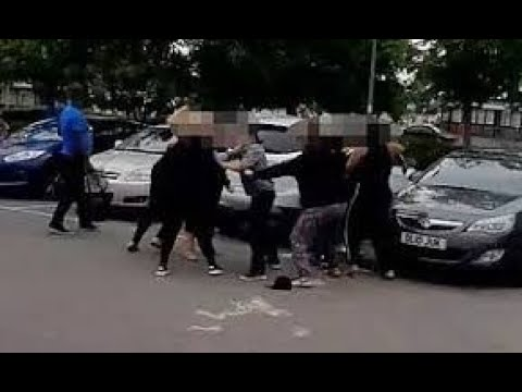 Download Women tear out each other's extensions in violent brawl outside KFC