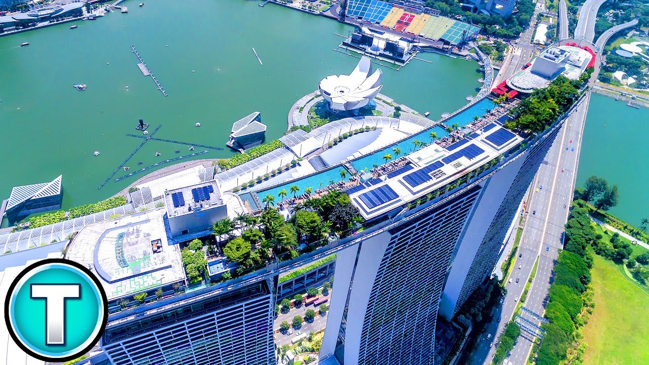 World 39 s highest swimming pool 57th floor of sands marina bay hotel youtube for Tallest swimming pool in the world