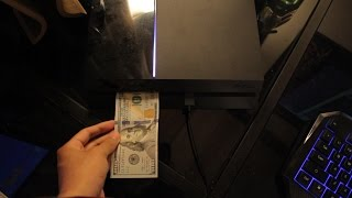 WHAT HAPPENS WHEN YOU PUT A $100 DOLLAR BILL IN A PS4?