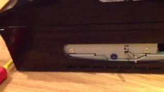 How to take out the blue screw on the back of a PS3 (when t