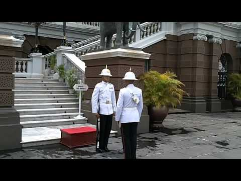Thai royal guard checks his mobile phone at Bangkok royal palace