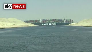 Stuck at sea: Cargo ship wedged in Suez Canal causes traffic jam