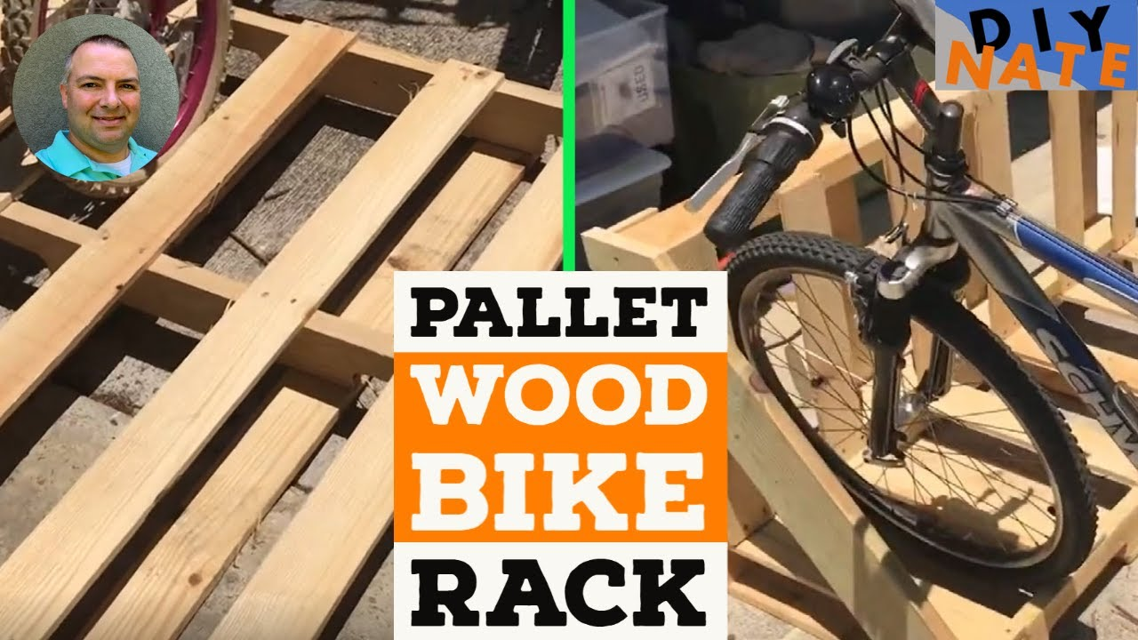 build an awesome bike rack from a wood pallet great garage space saver by diy nate
