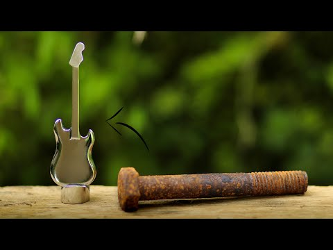 Turning a Old rusty Hex Bolt into a beautiful GUITAR from start to finish.