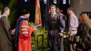 Paralyzed grad goes viral walking across stage