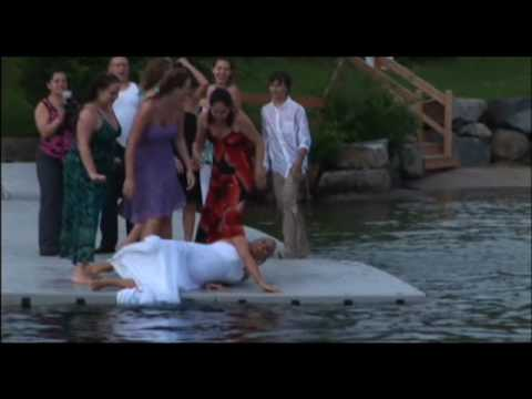 Bride jumps in Lake Winnepausakee with Wedding Dress!