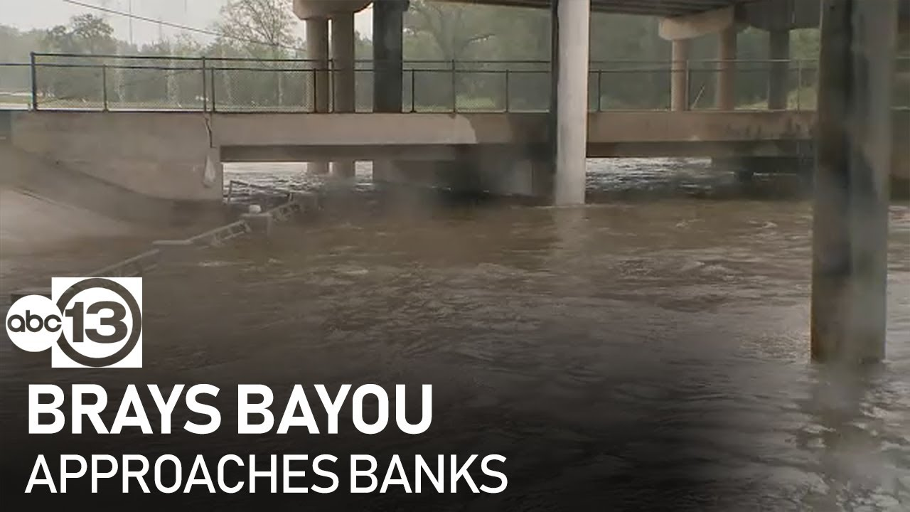 Brays Bayou approaches banks near Braeswood
