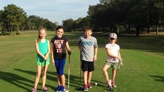 The Kids playing Golf at Walt Disney World