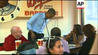President Barack Obama feasted on barbecue with four people who wrote him letters in a trip to highl