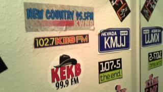 Check Out 30 Years of Bumper Stickers in the KEKB Bathroom