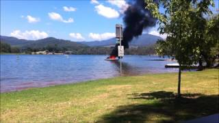 Boat on fire after water-skiing. Jet ski saves the day !
