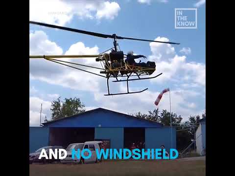 Would you ride this open-air helicopter? 🚁😱