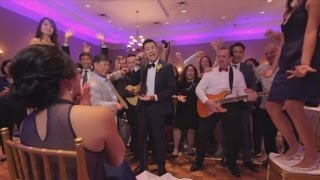 Newlyweds Create Over-the-Top Music Video with Wedding Guests in One Take(A couple surprised their 250 wedding guests with a night of activities but they saved the best for last. Robert and Teresa's friends and family were given the task ..., 2015-08-26T18:00:59.000Z)